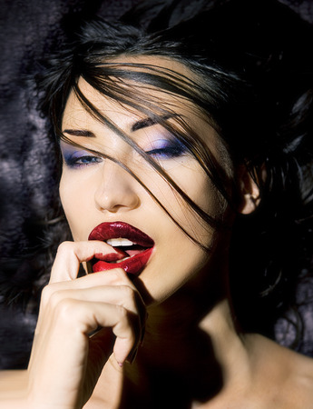 Fashion Beauty. Manicure and Make-up. Beautiful Woman With Colorful Nails and Luxury glossy Makeup and Indian accessory. Beautiful Emotional Girl Face photo