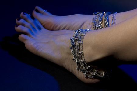 oriental jewelry: female feet with beautiful national indian jewellery, tribal style photo