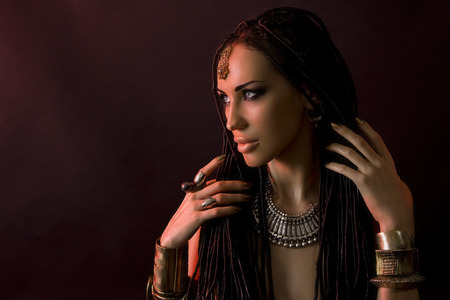 cornrows: Fashion Beauty. Mystic Make-up. Beautiful Woman With Luxury glossy gold Makeup and stylish hair (dreadlocks) . Beautiful sensitive Girl Face, indian accessories (oriental jewelry)