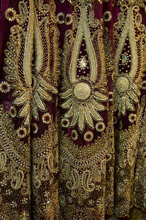 bead embroidery: Colorful Eastern Decorated Fabric on the Indian Market on Sari Store in Jaipur, Indian Fashion
