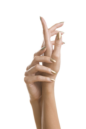 Golden Stylish Manicure, Female Hands with Shiny Golden Nail Polish isolated on white background. Makeup, fashion, beauty photo