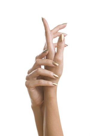 Golden Stylish Manicure, Female Hands with Shiny Golden Nail Polish isolated on white background. Makeup, fashion, beauty Stockfoto