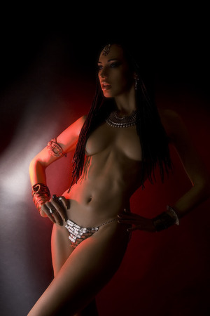 cornrows: Fashion Beauty and Stylish Hair (dreadlocks). Beautiful Sexy Woman With Luxury glossy gold eastern Make-up  and tribal accessories. Indian accessories (oriental jewelry)