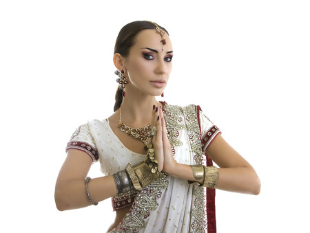 namaste: Beautiful Young Indian Woman in Traditional Clothing with Bridal Makeup and Oriental Jewelry. Namaste: Beautiful Girl Bollywood dancer (Bellydancer) in Sari. Eastern fairy tale Stock Photo