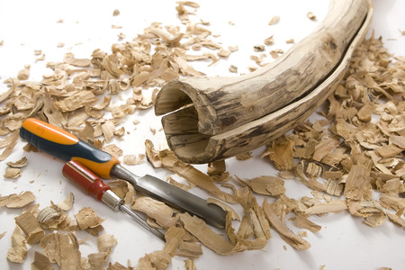australasian: Didgeridoo Making: Wooden Didgeridoo carving at home Close-up, imitation the tree that has been hollowed out by termites. Two Parts of Didgeridoo