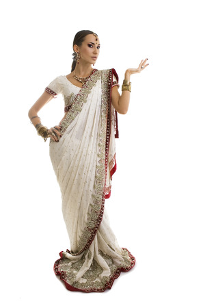 namaste: Beautiful Young Indian Woman in Traditional Clothing with Bridal Makeup and Oriental Jewelry. Beautiful Girl Bollywood dancer (Bellydancer) in Sari with open Hand palm.