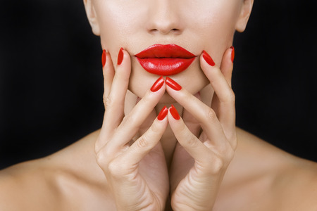 glistening: Sexy Young Beautiful  Girl with Red Lips and Red Nail Polish, Bright Glistening  Shining Make-up Closeup on Dark Background (black)