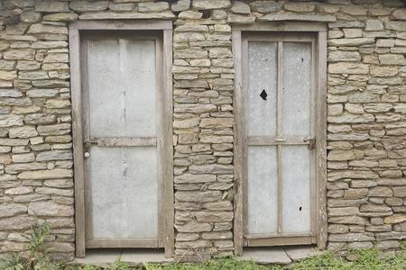 fanlight: The Old wooden Door, Background. Old stone brick wall: Texture of vintage brickwork - stone brick