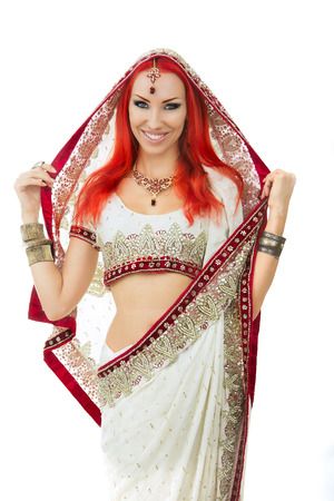 sexy costume: Beautiful Redhead Young Sexy Woman in Traditional Indian Clothing with Bridal Makeup and Oriental Jewelry. Beautiful Smiling Girl Bollywood dancer (Bellydancer) in Sari. Eastern fairy tale Stock Photo