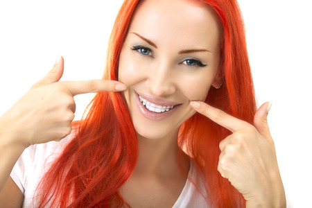Beautiful Smiling Redhead Girl showing Retainer, Braces for Teeth. Orthodontics Dental Theme, Methods of Teeth (Bite) Correction, Close-up 스톡 콘텐츠