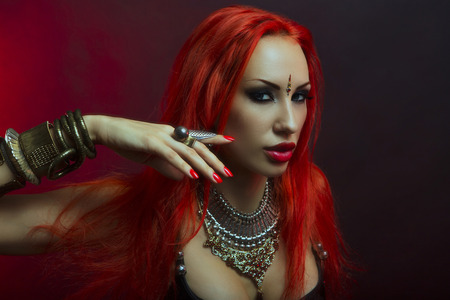beautiful redhead: Bellydance, Tribal Fusion. Beautiful Redhead Young Woman in Sexy Clothing with Eastern Makeup and Luxury Oriental Jewelry. Beautiful Girl Hot Bollywood Dancer (Sensitive Bellydancer). Eastern fairy tale, Harem Stock Photo