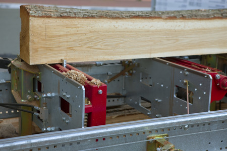 wood turning: Woodworking the Machine Tool, Wood factory Outdoors, Close-up. Steel Band saw Machine working in Factory