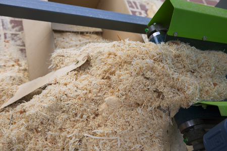 carpenter's bench: Woodworking the Machine Tool, Wood factory Outdoors, Close-up. Steel Band saw Machine working in Factory. Wood Shavings Stock Photo