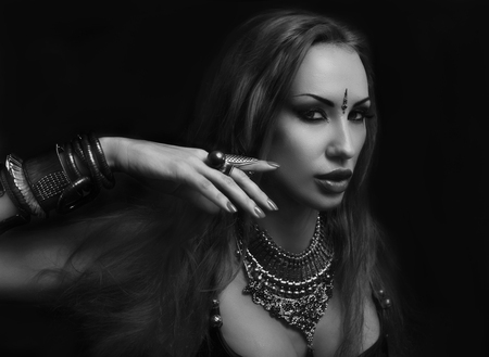 bellydance: Bellydance, Tribal Fusion. Beautiful Young Woman in Sexy Clothing with Eastern Makeup and Luxury Oriental Jewelry. Beautiful Girl Hot Bollywood Dancer (Sensitive Bellydancer). Eastern Harem. black and white