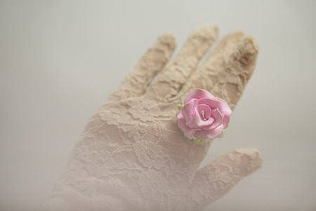 lace gloves: Romantic vintage retro style: Polymer clay jewelery: Fashion studio blurred  shot of Female hand in lace gloves with a beautiful rose floral ring, vintage accessories. Spring - Summer fashionable accessories, soft focus