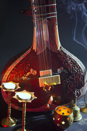 shankar: Sitar, a String Traditional Indian Musical Instrument, close-up, blue lens effect. dark background with incense smoke. Evening of ethnic oriental music. Indian Raga
