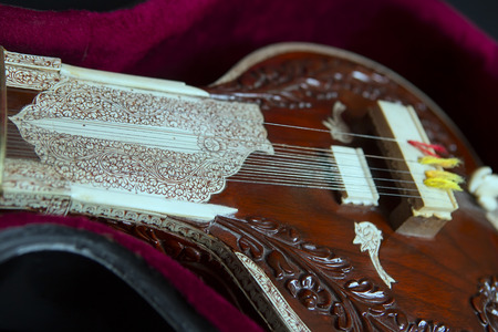 indian culture: Sitar, a String Traditional Indian Musical Instrument, close-up, blue lens effect. dark background. Evening of ethnic oriental music. Indian Raga