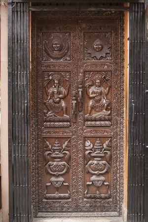 east gate: Beautiful old Wooden Door, Vintage antique Door with ornament in KATHMANDU, NEPAL