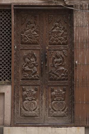 wood carving door: Beautiful old Wooden Door, Vintage antique Door with ornament in KATHMANDU, NEPAL