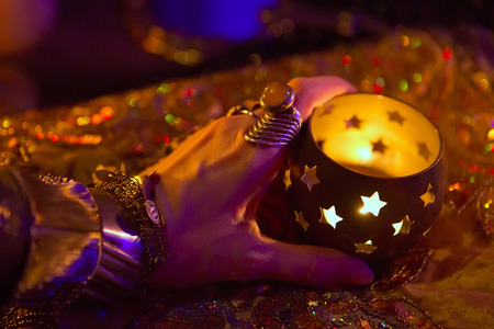 wedding accessories: Golden Oriental Jewelry Accessories: Female Hands with beautiful National Indian Jewellery, Eastern Fairy Tale (Harem), Wedding Fashion. Eastern Treasure Chest by Candlelight. Luxury Arabian Interior