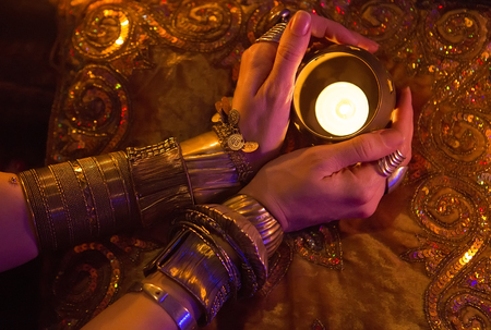 arabian harem: Golden Oriental Jewelry Accessories: Female Hands with beautiful National Indian Jewellery, Eastern Fairy Tale (Harem), Wedding Fashion. Eastern Treasure Chest by Candlelight. Luxury Arabian Interior