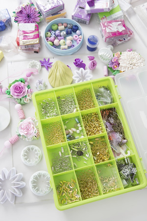 bead embroidery: Accessories for needlework in container and tools for creating fashion jewelry in the manufacturing process. Jewelry Making. Workshop. Hobby � Bijouterie Modeling. Tools for Handmade