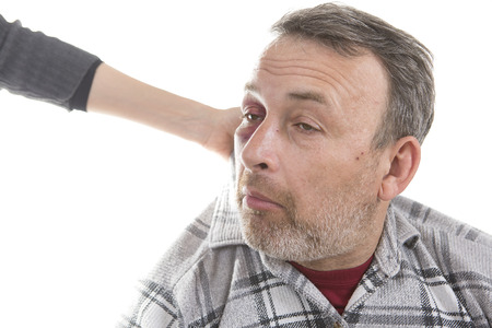 swollen: Female hand holding a Man with Black Eye by the collar. Shiner. Mans face after the fight and assault. Middle-aged Caucasian male Emotional Portrait with a Real Bruise. Violence in family