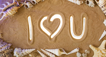 i love u: I Love You Symbol in the Sand. Beach background. Top view. Romantic concept: I love U icon is Highlighted by Rays of Light. Beautiful Romantic Sandy Background. Sea Leisure
