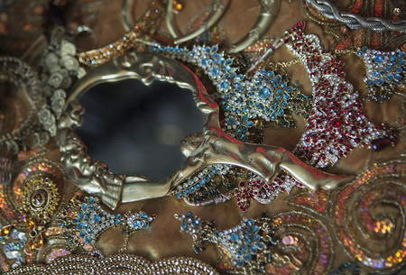 antique jewelry: Antique Mirror and Golden Luxury Oriental Jewelry and Accessories: Female Hands with beautiful National Indian Jewellery, Eastern Fairy Tale, Wedding Fashion and Beauty. Eastern Treasure Chest