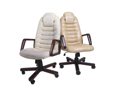 Old Crannied and New Office Boss Chair (armchair). Restoration of Old Furniture, before and after. Replacing Material, update. Dermatin chair requiring tissue replacement, instauration Stock Photo