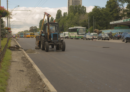 vibrator: Kyiv, Ukraine Jul 2016: Road Paving, construction. Workers laying stone mastic asphalt during street repairing works 2016 in Kyiv on Peremogy ave - One of the central roads of Kiev