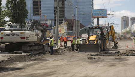 road paving: Kyiv, Ukraine Jul 2016: Road Paving, construction. Workers laying stone mastic asphalt during street repairing works 2016 in Kyiv on Peremogy ave - One of the central roads of Kiev