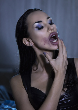 Sexy Emotional Beautiful Woman Rubbing Lipstick. Passionate lover, Seductress. Passion, Smeared lipstick. Temptress. Beauty Face with sloppy makeup, Sexy Sensual fatal Girl. Provocative crazy look Stock Photo