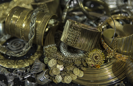 chainlet: Golden jewelry. Lot of Beautiful Oriental Gold (Indian, Arab, African). Fashion Ethno Accessories, Asian Bridal jewelry. Tribal Moroccan belly Dance Jewelry. Necklace, Earrings, Bracelets. Stock Photo