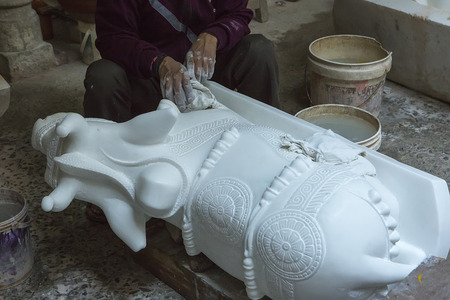 indian animal: Statues of Hindu Gods. Nandi - Shivas bull. Crafts and Arts of India. Murti handmade Manufacturing in Jaipur (Rajasthan). Indian God sculpture made of white marble. Ancient Traditions and Crafts of India. Editorial