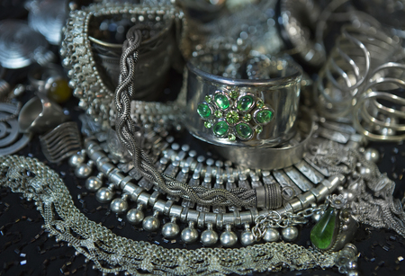 chainlet: Silver jewelry with Emerald. Lot of Beautiful Oriental Silver, Gold (Indian, Arab, African). Fashion Ethno Accessories, Asian Bridal jewelry. Tribal Moroccan Jewelry. Necklace, Earrings, Bracelets  Stock Photo