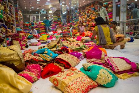 JAIPUR, Rajasthan, India – DEC, 2016: Sari Shop. Indian Traditional Womens Luxury Sari clothing on Market on Dec, 2016 in JAIPUR, India. Jaipur - center of Traditional eastern Handicrafts of India Editorial
