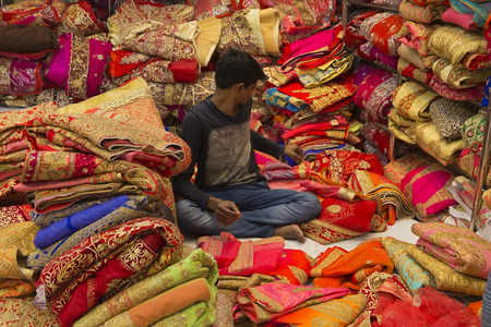 JAIPUR, Rajasthan, India – DEC, 2016: Sari Shop. Indian Traditional Womens Luxury Sari clothing on Market on Dec, 2016 in JAIPUR, India. Jaipur - center of Traditional eastern Handicrafts of India Editorial