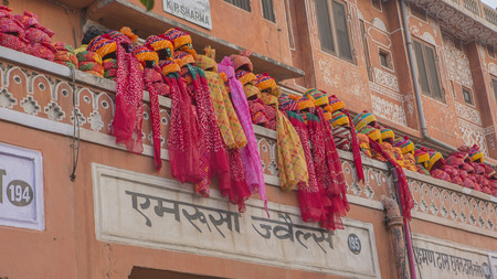 JAIPUR, INDIA – DEC 2017: Indian Turbans on the street - a Traditional Headgear of Rajputs on Dec, 2017, Jaipur, India. Rajasthan is one of the most important centers of Commerce in India