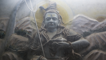 kali: God Shiva Murti in Jaipur Temple near Under dusty glass with spiderweb. Statues of Hindu Gods and Goddess in Rajasthan. Shiva Bolenath sculpture in hindu Mandir.