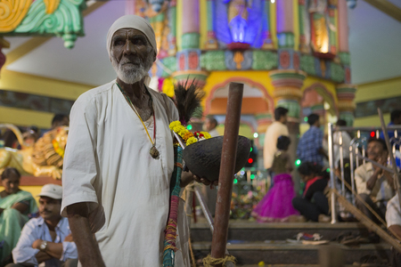 GOA, India – Oct, 2017: Indian Baba blessing people at the feast. Sadhu near the temple on Oct 2017, GOA, India. Diwali in India - a festival of lights - Means victory of light over darkness