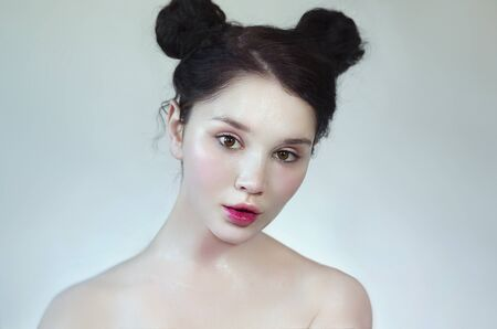 Natural beauty close up, baby-face style makeup. Portrait of a young pretty girl with natural makeup. Clean youthful skin. Beautiful Doll Face, Wet Highlighter and pink lip gloss