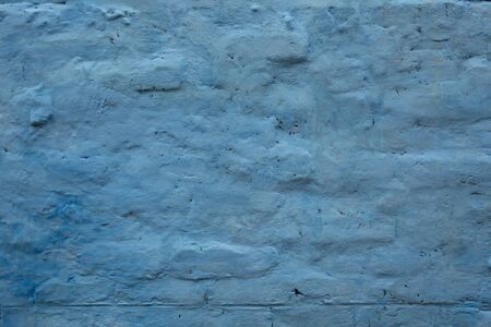 Blue Grunge wall of the old house. Textured background. Cracked concrete vintage wall background, old wall painted blue.