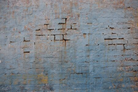 Grunge wall of the old house. Textured backgroundCracked concrete vintage wall background, old wall painted blue. Textured background 版權商用圖片