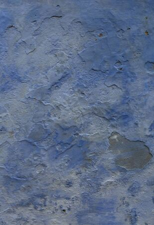 Blue Grunge wall of the old house. Texture, background. Cracked concrete vintage wall background, old wall painted blue.