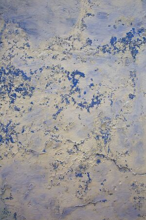 Blue Grunge wall of the old house. Texture, background. Cracked concrete vintage wall background, old wall painted blue