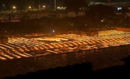 AYODYA, INDIA – Oct 2019: People celebrate Diwali Hindu Festival of Lights near the sacred river in Ayodya, India on Oct, 2019. Diwali (Deepavali) in Ayodhya celebrated with a military parade