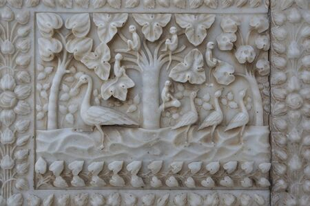 Marble carved wall in the Karni mata Temple (rat temple) in Rajasthan, Deshnok village.Texture of carved pattern on white marble. Indian architecture, detail