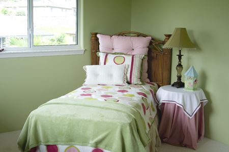 A colorful young girls bedroom. photo