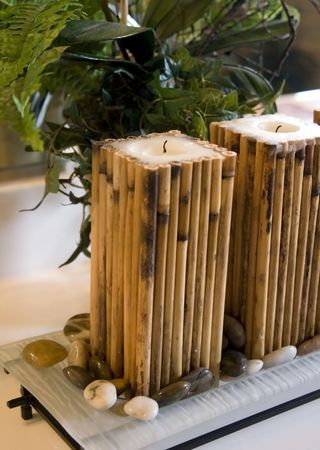 A spa set up with bamboo candles.